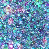 Scattered Gem and Sequin Print. Multicolour sequins and gems create this abstract sparkle background print Royalty Free Stock Photo