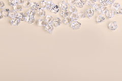 Scattered glass diamond chunks on a cream background Royalty Free Stock Photography