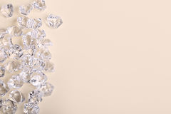 Scattered glass diamond chunks on a cream background Royalty Free Stock Photo