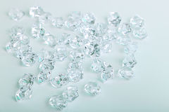 Scattered glass diamond chunks on a white background Royalty Free Stock Photos