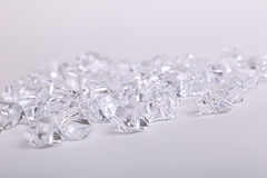 Scattered glass diamond chunks on a white background Stock Image