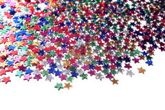 Scattered glittering stars confetti. Close up. Royalty Free Stock Image