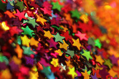 Scattered glittering stars confetti closeup Stock Images