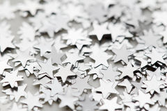 Scattered glittering stars confetti Stock Photo