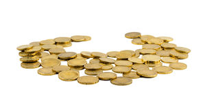 Scattered gold coins. With empty space in teh middle on white background royalty free stock photo