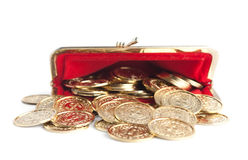 Scattered gold coins are in hot red purse Royalty Free Stock Images