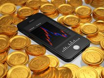 Scattered gold colored Bitcoins and Smartphone stock photography