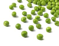 Scattered green peas over white background. Isolated with clippi Stock Photos