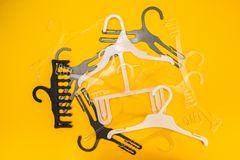 Scattered hangers on yellow background stock images