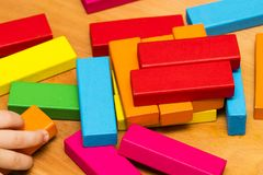 Scattered heap of toy colored wooden bricks Royalty Free Stock Photos