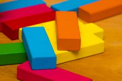 Scattered heap of toy colored wooden bricks Royalty Free Stock Photography