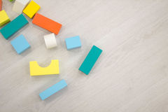 Scattered heap toy colored wooden bricks Royalty Free Stock Image
