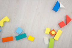 Scattered heap toy colored wooden bricks Stock Photos