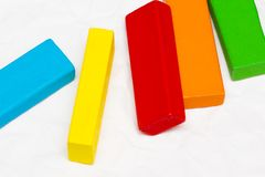 Scattered heap of toy colored wooden bricks on a white backgroun Royalty Free Stock Photos