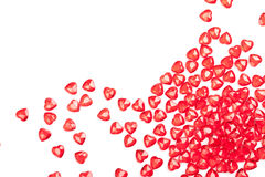 Scattered Hearts. Some red plastic hearts scattered onto a white background Stock Image