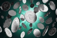 Scattered IOTA coins on a lighted background. Success concept. Scattered IOTA coins on a lighted background. Success and growth concept. Perfect for covers Stock Photo