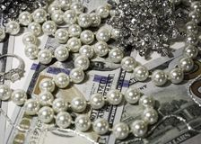 Scattered Jewels on Top of Money Stock Image