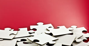 Scattered jigsaw pieces Stock Photo