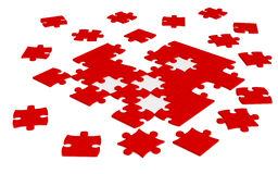 Scattered jigsaw puzzle. Close up of isolated red  scattered  jigsaw puzzle pieces Royalty Free Stock Photos