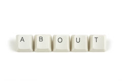 About from scattered keyboard keys on white Stock Photography