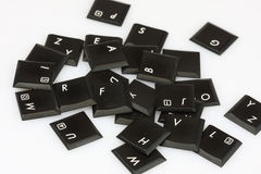 Scattered letters. Scattered keyboard letters on white background Royalty Free Stock Image