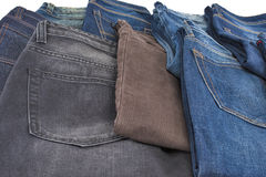 Scattered male jeans Stock Photography