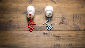 Scattered from medical bottle red and blue pills Royalty Free Stock Image