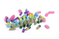 Scattered medicine. Pills, capsules and tablets scattered on white background royalty free stock photos