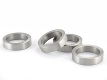 Scattered Metal Rings. Scattered Brushed Metal Rings Isolated; macro stock photography