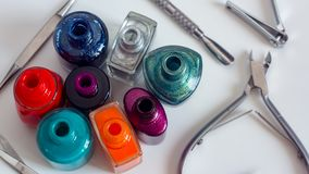 Scattered nail Polish with Manicure and pedicure tools in the beauty salon or beauty shop. The choice of color nail Polish for royalty free stock photos