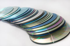 Scattered old compact discs on a white background Royalty Free Stock Image