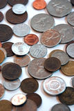 Scattered old foreign coins Royalty Free Stock Images