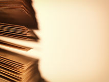 Scattered pages of an open book, on beige Stock Photo