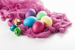 Scattered painted easter chicken and quail eggs on a white backg Royalty Free Stock Photos