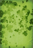 Scattered paper shamrocks. Textured clover leaf page Stock Photos
