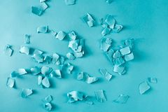 Scattered paper shreds on blue Stock Images