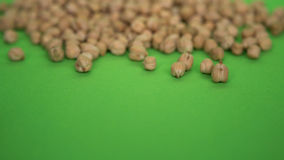Scattered peas on a green background. Little spilled peas on a green background Royalty Free Stock Photos