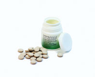 Scattered pills. With plast bottle with small depth of field Royalty Free Stock Photo