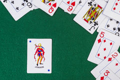Scattered playing cards with the joker Stock Photos