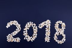 2018 is scattered from popcorn on a blue background to the right. Royalty Free Stock Image