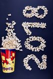 2018 scattered over popcorn on a blue background. Stock Image