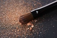 Scattered powder and make up brush Royalty Free Stock Photography