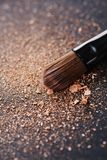 Scattered powder and make up brush Royalty Free Stock Photo