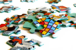 Scattered puzzle pieces. Puzzle pieces on a white background Stock Photography