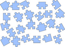 Scattered puzzle pieces. Isolated over a white background Stock Photos