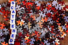 Scattered puzzle pieces Stock Images