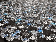 Scattered Puzzle Pieces. With a highlight of aqua blue Stock Images