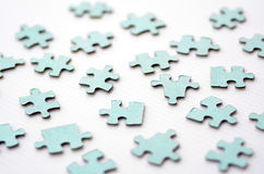 Scattered puzzle pieces Royalty Free Stock Image