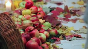 Scattered Red Apples Lie on a White Canvas stock video footage