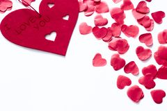 Scattered red hearts on a white background. Excellent background to the day of Saint Valentine.copy space stock photo